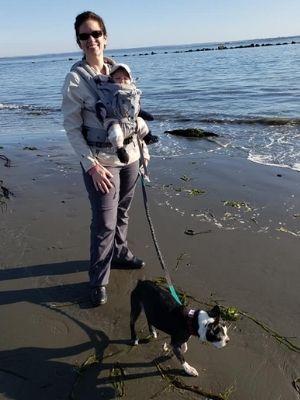 Lorien and Sagan walking Penny on the beach