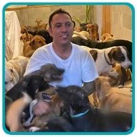 Ricardo in house with dogs