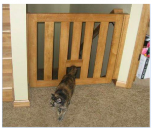 Natural wood baby gate with cat flap